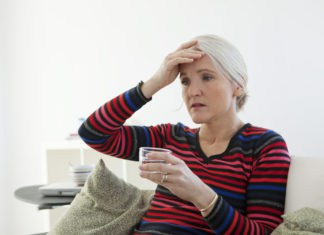 Woman experiencing menopause pains