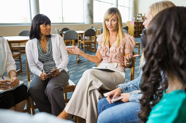 woman-in-support-group_vx5f2a How can you reduce the stress of divorce