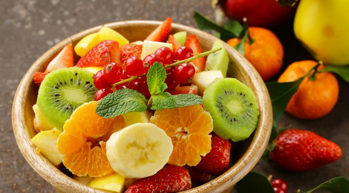 Fresh organic fruit salad (kiwi, strawberry, banana, currant, ap