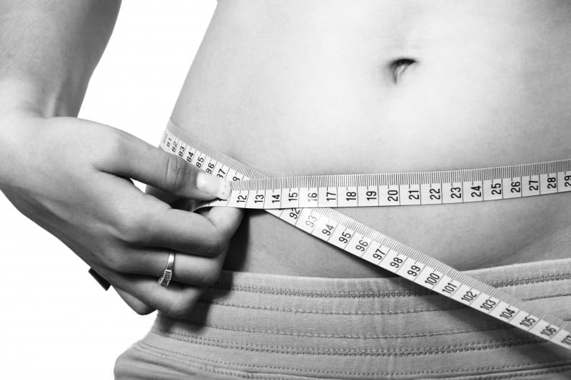 black-and-white-image-of-woman-measuring-belly 7 Reasons Why Your Diet Isn't Working