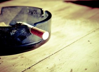 cigarette-and-ashtray-on-table