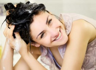 40657969 - cute girl in bathroom washing hair with shampoo