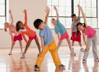 Children exercising fitness class