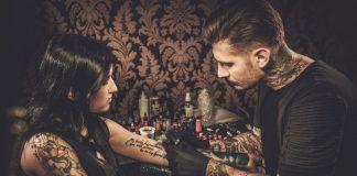 professional tattoo artist makes a tattoo